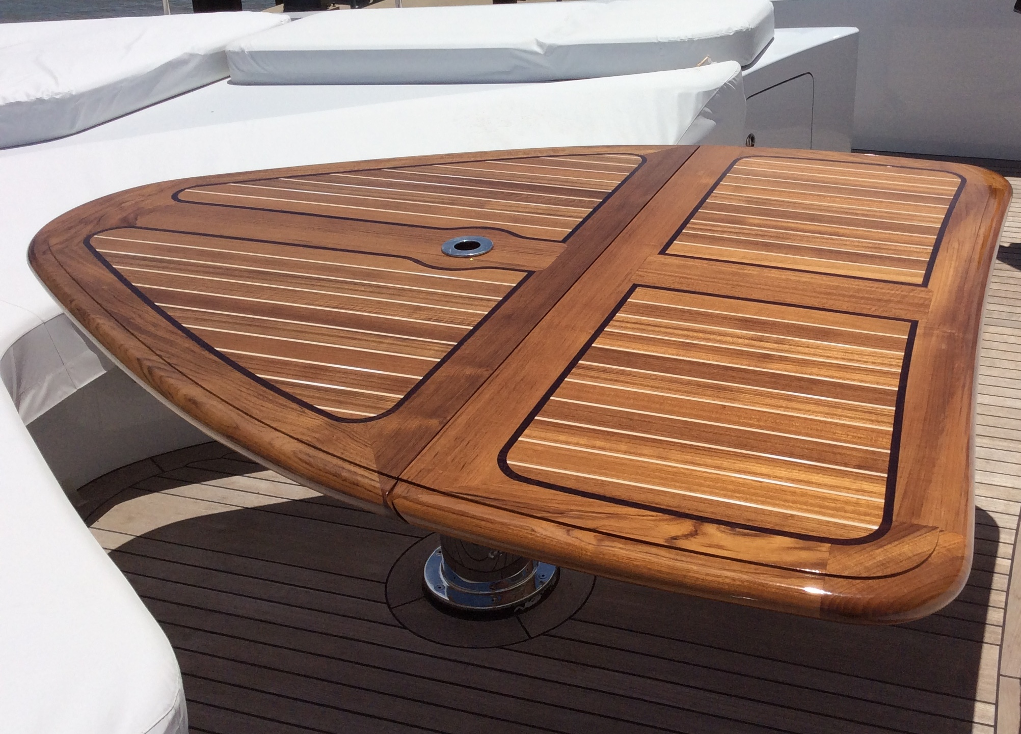 "Teak Folding Table on the vessel ""Flying Manta"""