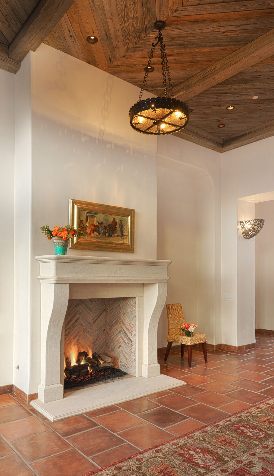 Bertelsen Residence 10 - Living Room Fireplace with cut limestone, sautillo tile and natural wood ceiling.jpg