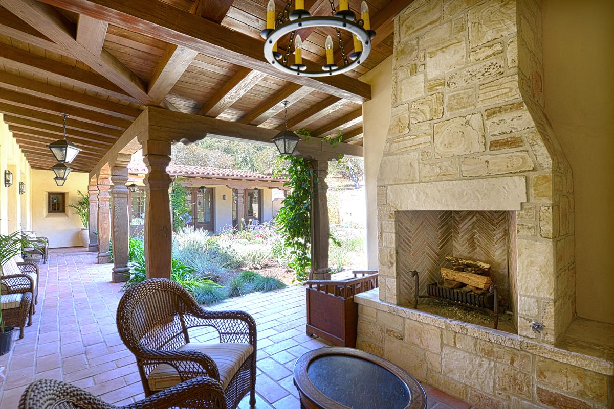 Lovett Residence 11 - Exterior, Fireplace Inside Courtyard Loggia.jpg