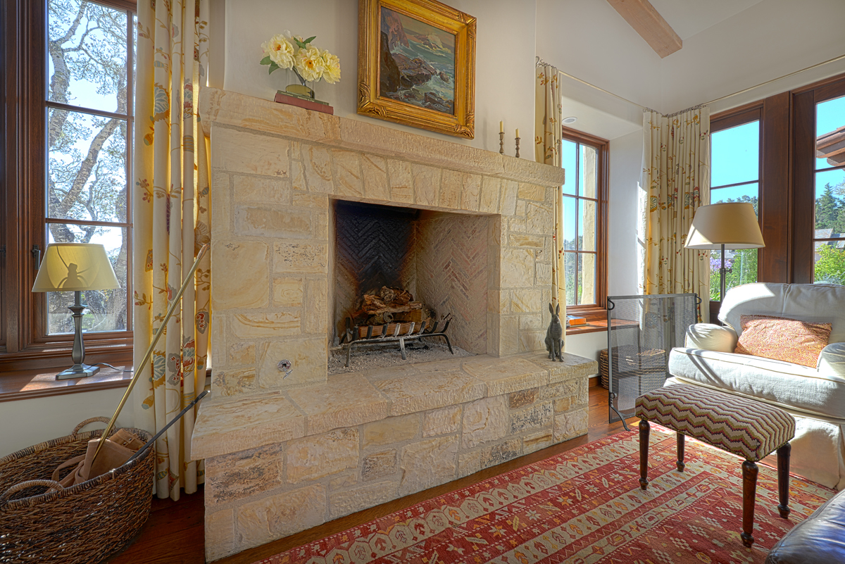 Lovett Residence 16 - Interior, Family Room Fireplace with Carved Carmel Stone and La Loma Windows and Doors.jpg