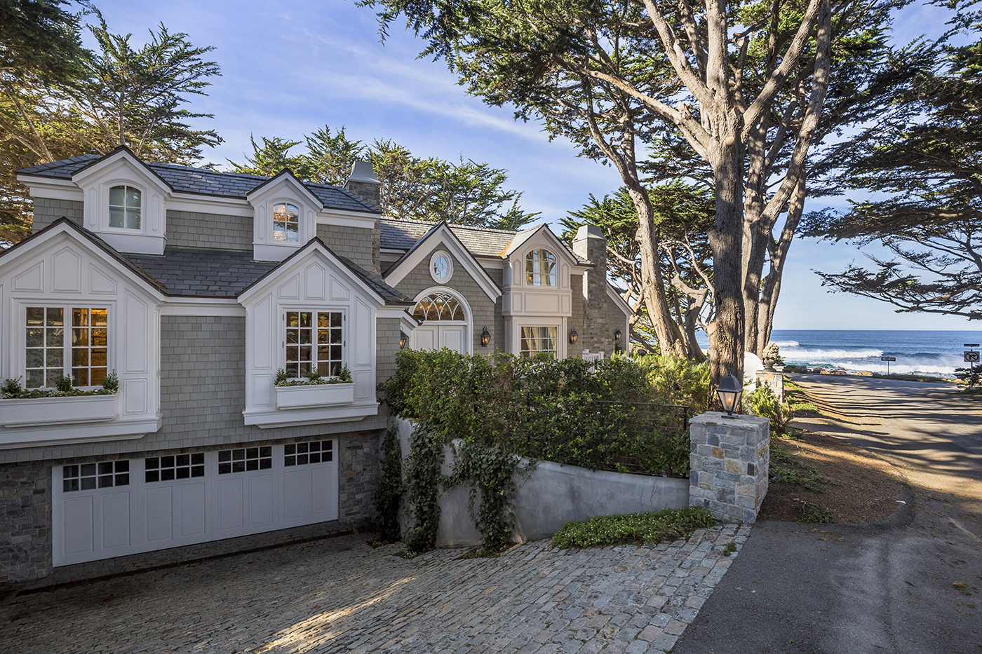 3 Ocean View - paver driveway and wood paneled bay windows and dormers.jpg