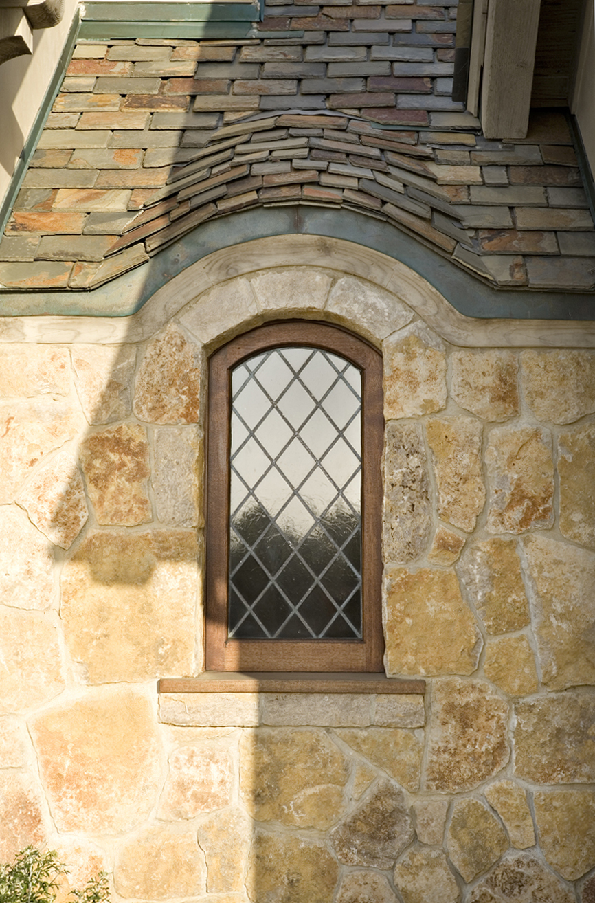7- Smith-arched stained glass window-barrel slate roof-stone.jpg