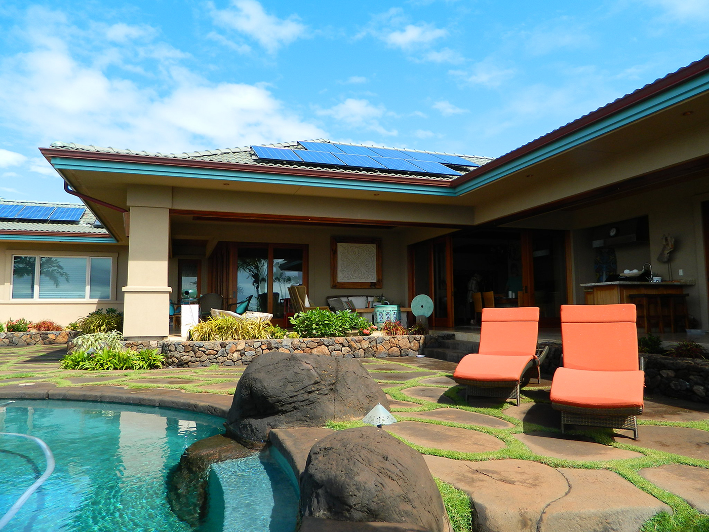 4 MAUI Residence - Lanai and custom pocket sliding wood doors.JPG