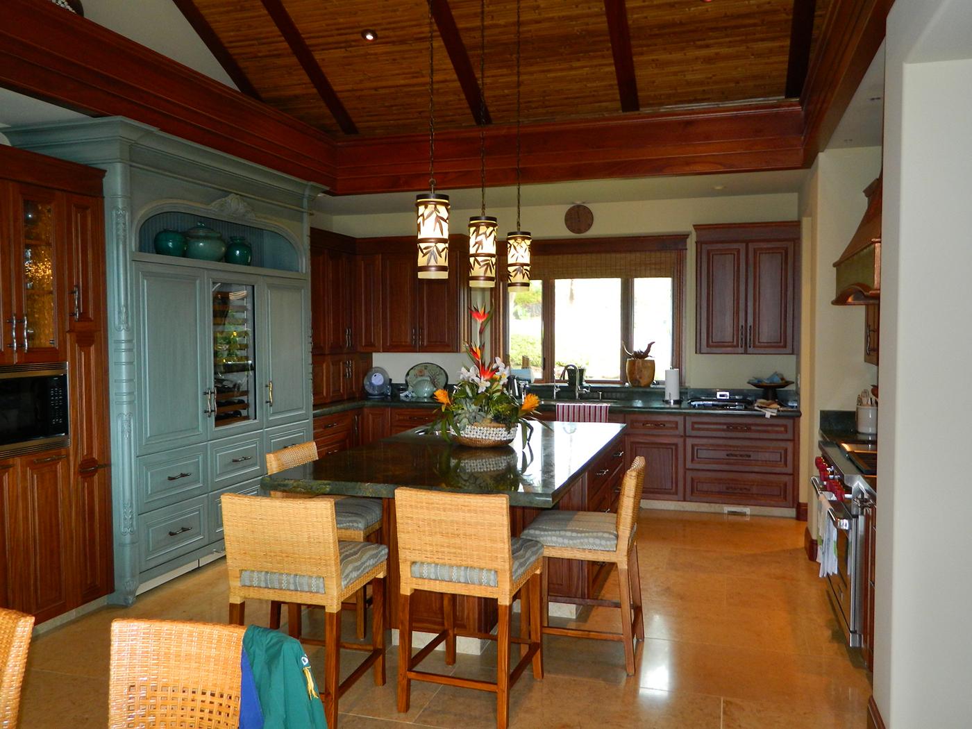13 MAUI Residence - Kitchen with custom wood carved refridgerator cladding.JPG