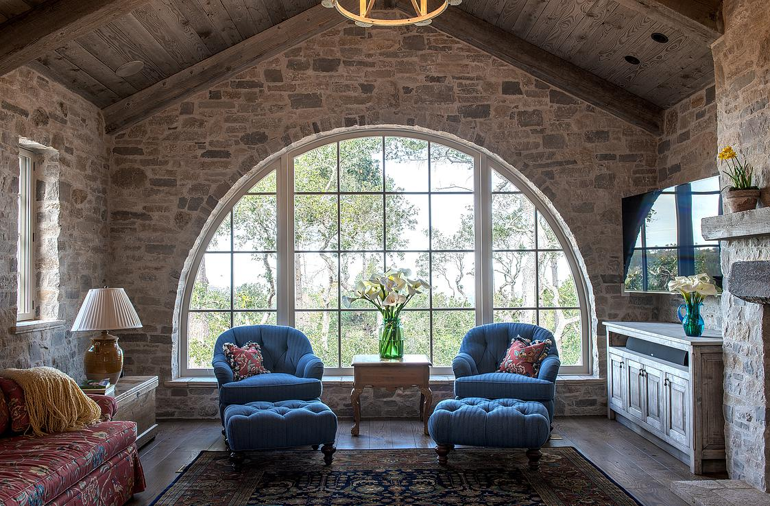 8 Smith Monterra Residence - family room as all stone building with arched windowe to view of monterey bay.jpg