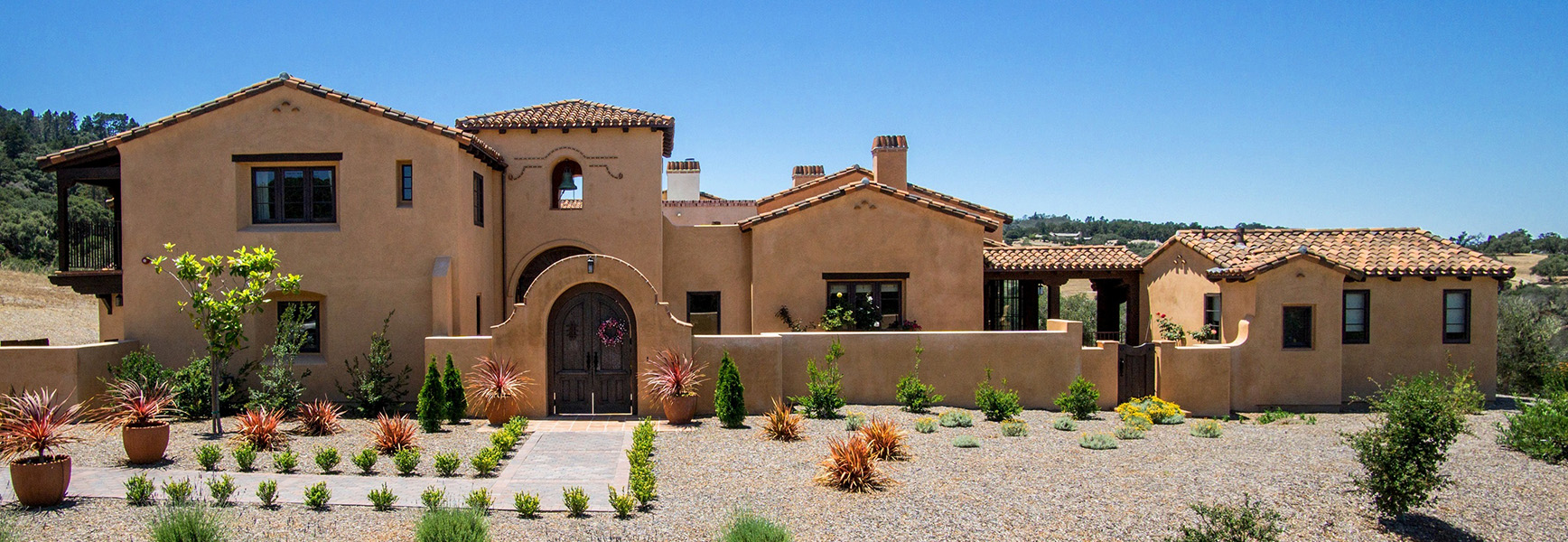 2 Kraft Residence - exterior-spanish hacienda with bell tower.jpg