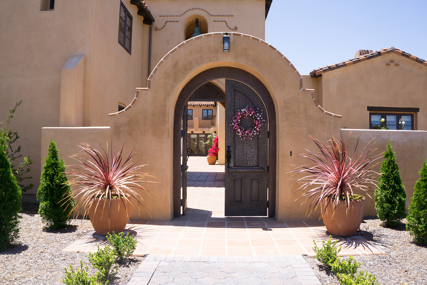 3 Kraft Residence - arched entry with carved wood gate.jpg