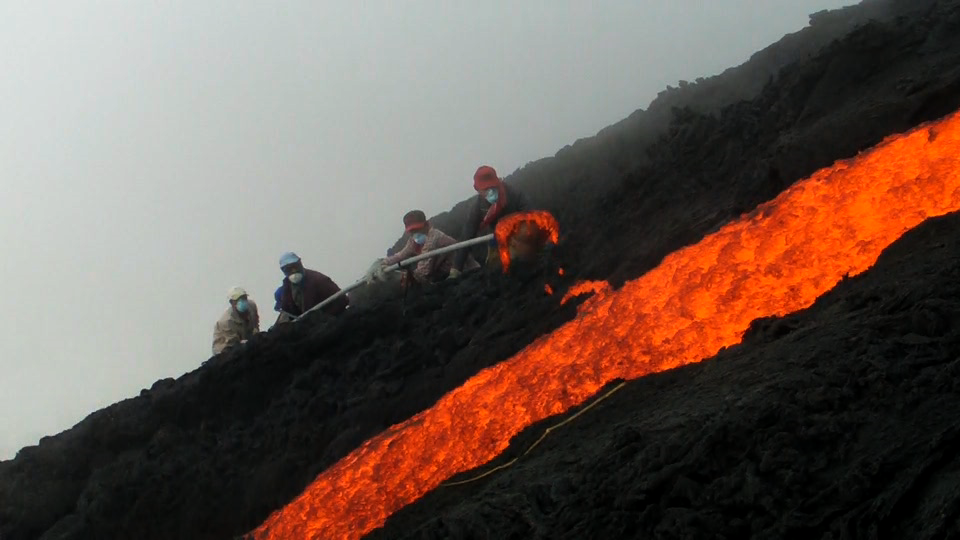 Danny with his crew casting lava directly from a flow on Volcano Pacaya, Guatemala. 2010.