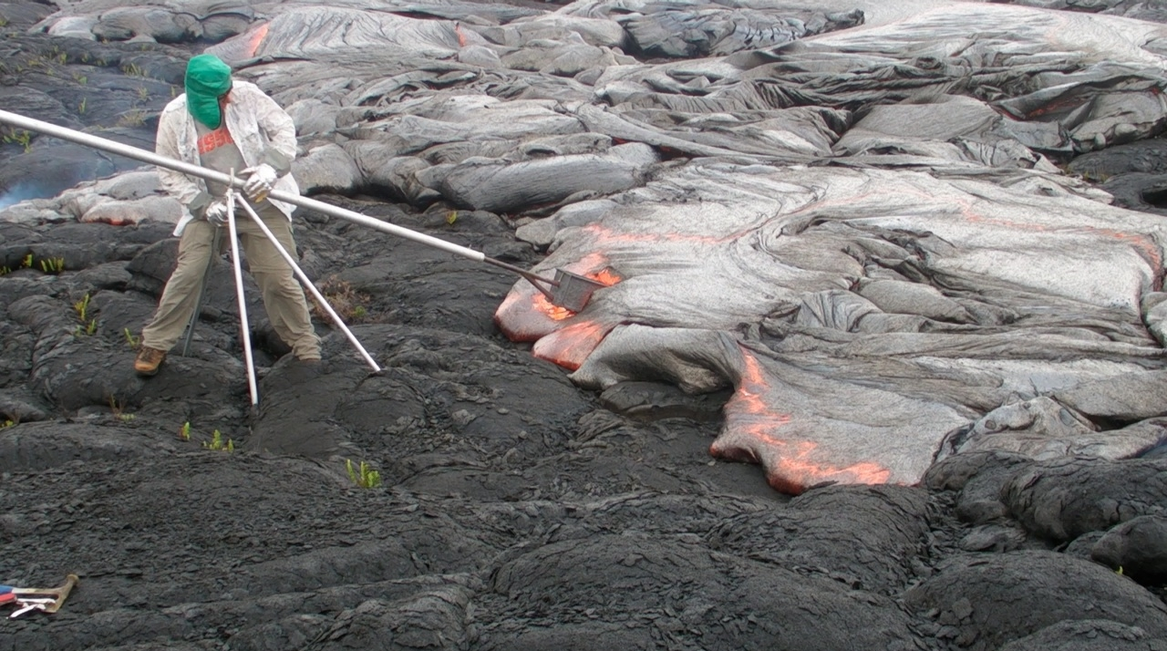 Gerry assisting Danny with casting lava on Kilauea Volcano, Hawaii, 2012.