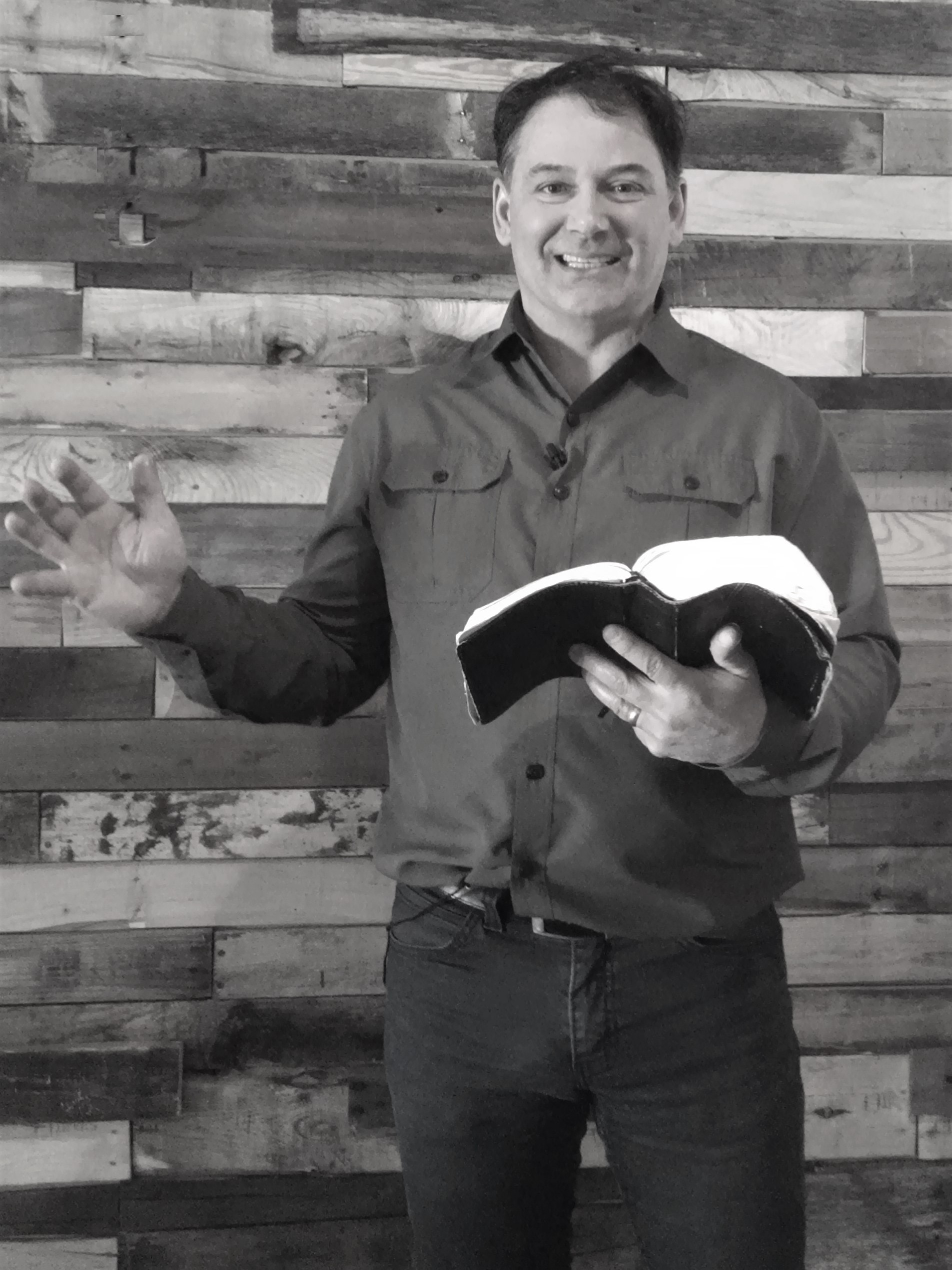 Doug with bible bw.jpg