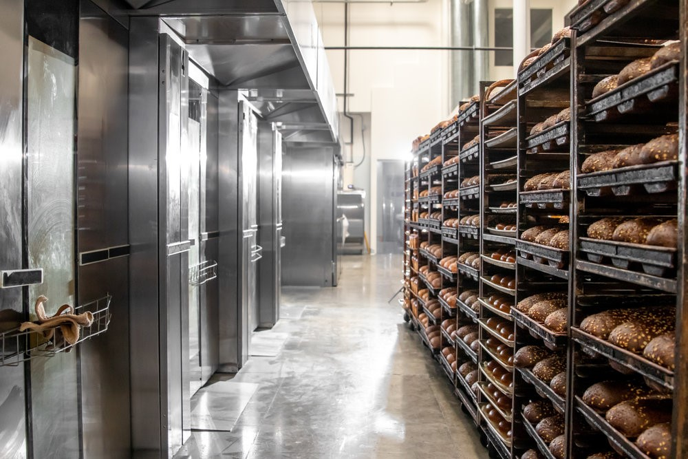 - Our facility runs 7 rack ovens which bake approximately 504 loaves simultaneously!