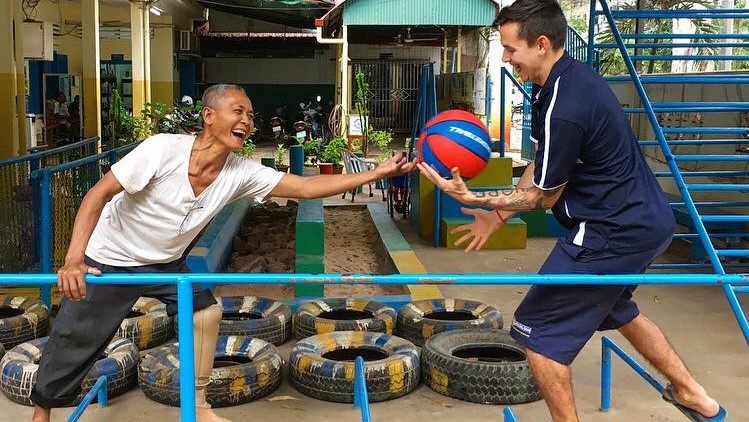 Notre Dame Ex Phys Cambodia 2017 Ellouise Clark - patient enjoying exercise session with student 16-9.jpg