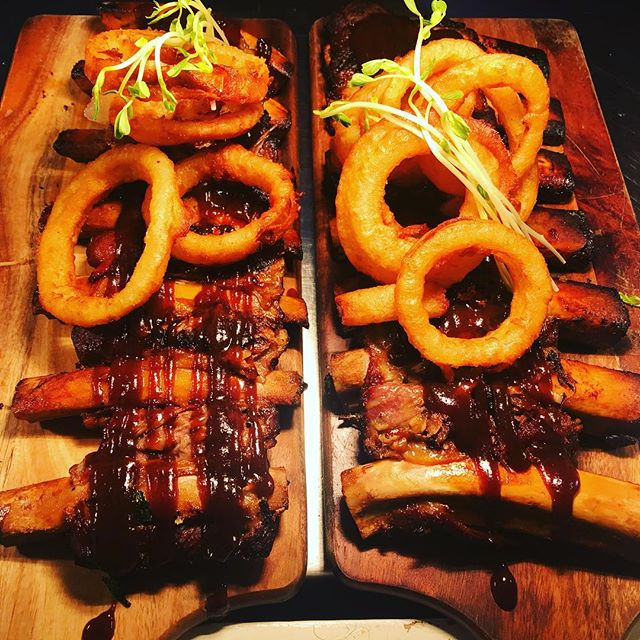 Smokey BBQ twice cooked ribs and onion rings. We cook them twice so you don't have to cook at all!!!
