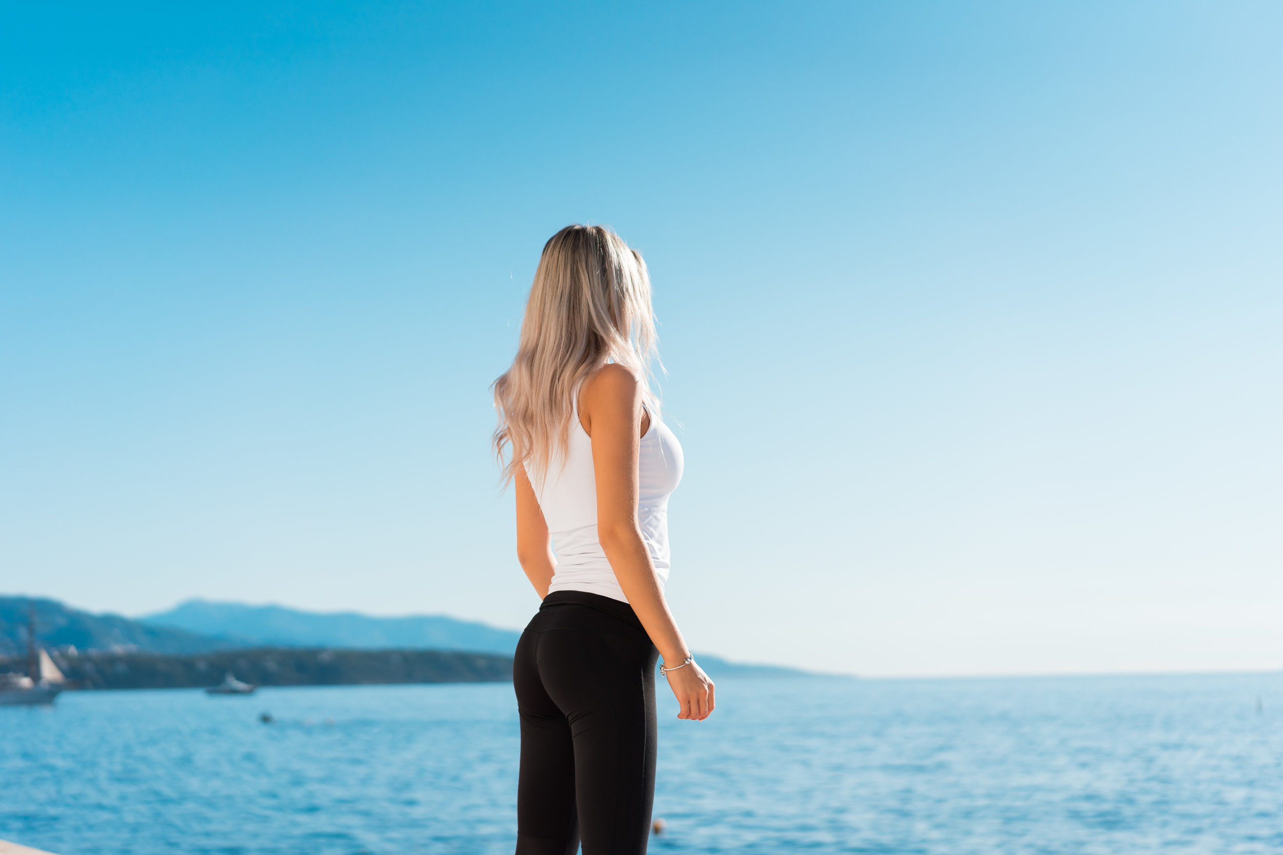 young-fitness-woman-overlooking-the-sea-in-the-morning-picjumbo-com.jpg