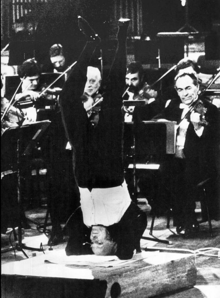 Yehudi Menuhin conducting from Sirsasana!