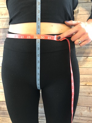 Rise &Circumference of Rise - First, starting at the back hold the tape measure at the height you would like your waistband to be, bring the tape through your legs and back up the front as shown with the blue tape. Secondly measure the circumference around where you want your waistband as show with the red tape.These measurements are critical for a skort, please continue below to learn skort measurements.