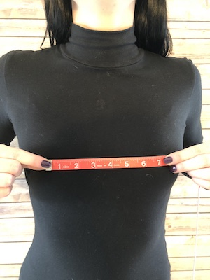 Center to Center Cup (bra inserts) - Measure from the center of your left cup to the center of your right cup (with your bra on)