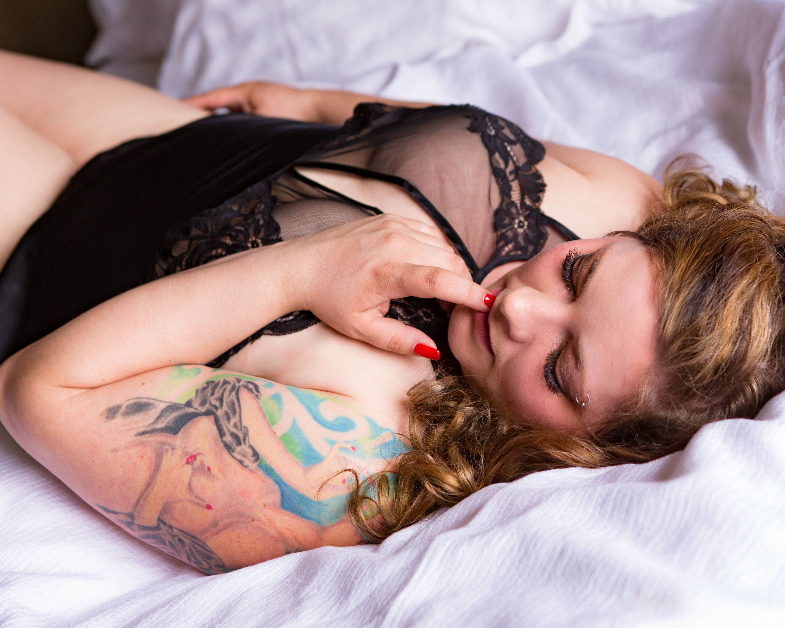 Woman biting her nails during boudoir session in Helena Montana by boudoir photographer Misty Boles