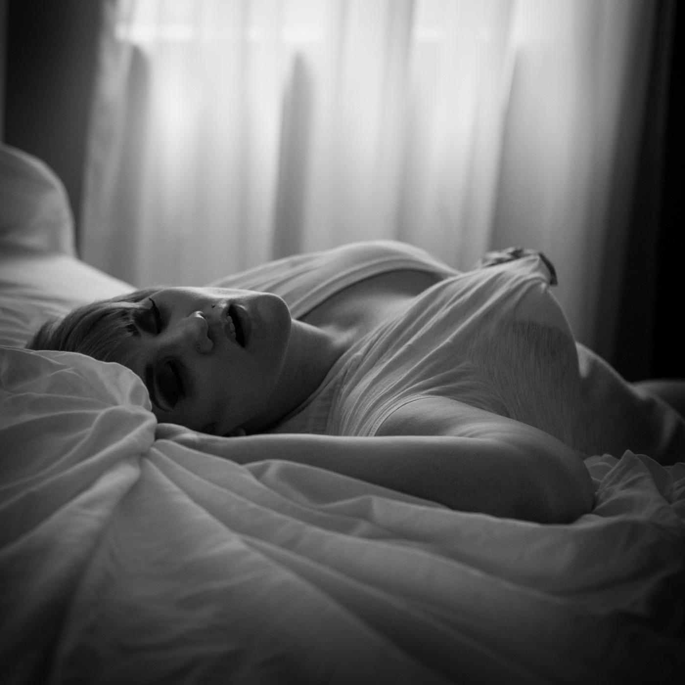 Woman grabbing white tee shirt. Boudoir session in Helena, Montana by boudoir photographer Misty Boles