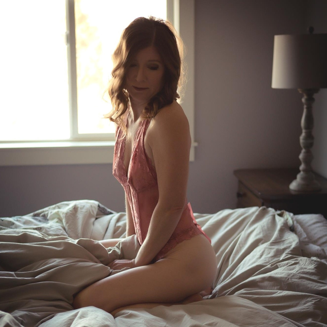 Boudoir Inspiration: Woman in peach colored lingerie.  Boudoir Photo by Misty Boles Intimate Photography.