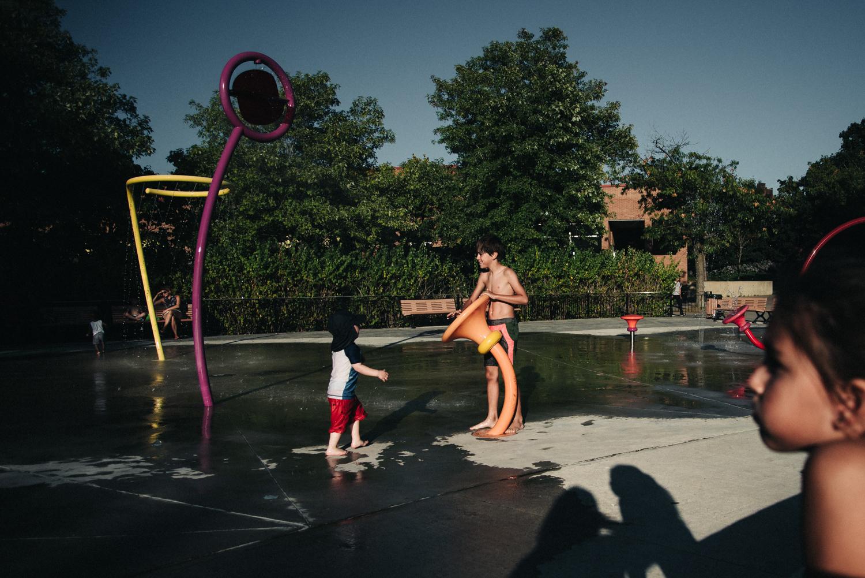 kids at a Montreal sprinkler park