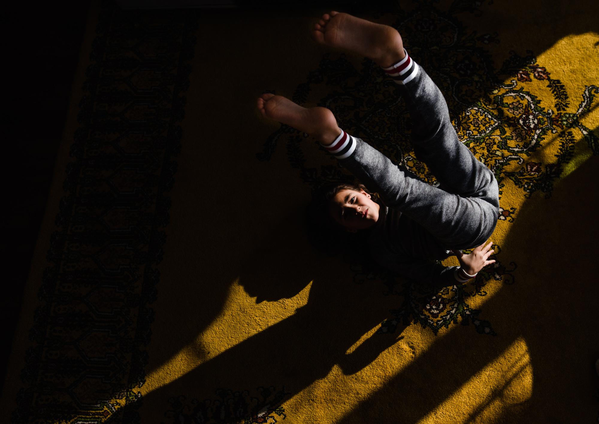 pocket of light gymnastic pose portrait