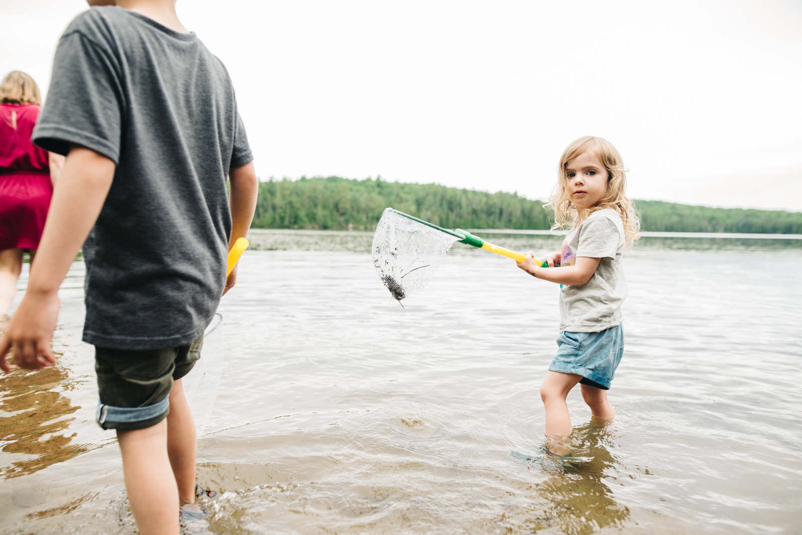 little girl catching fish at the lake in the laurentian.jpg