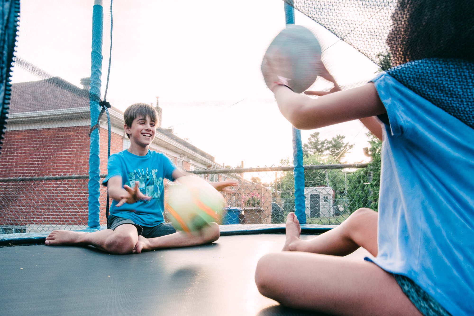 playing ball in the trampoline at sunset in Montreal