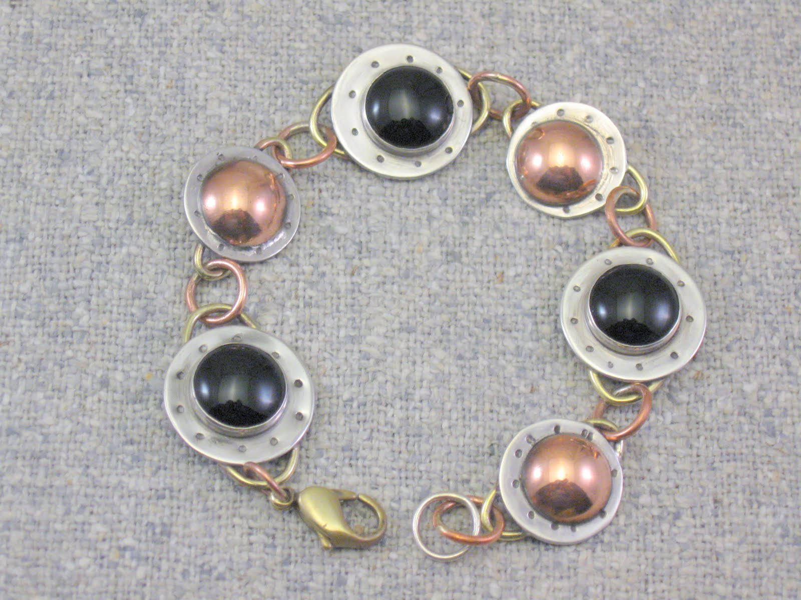 linked stones and  domes bracelet