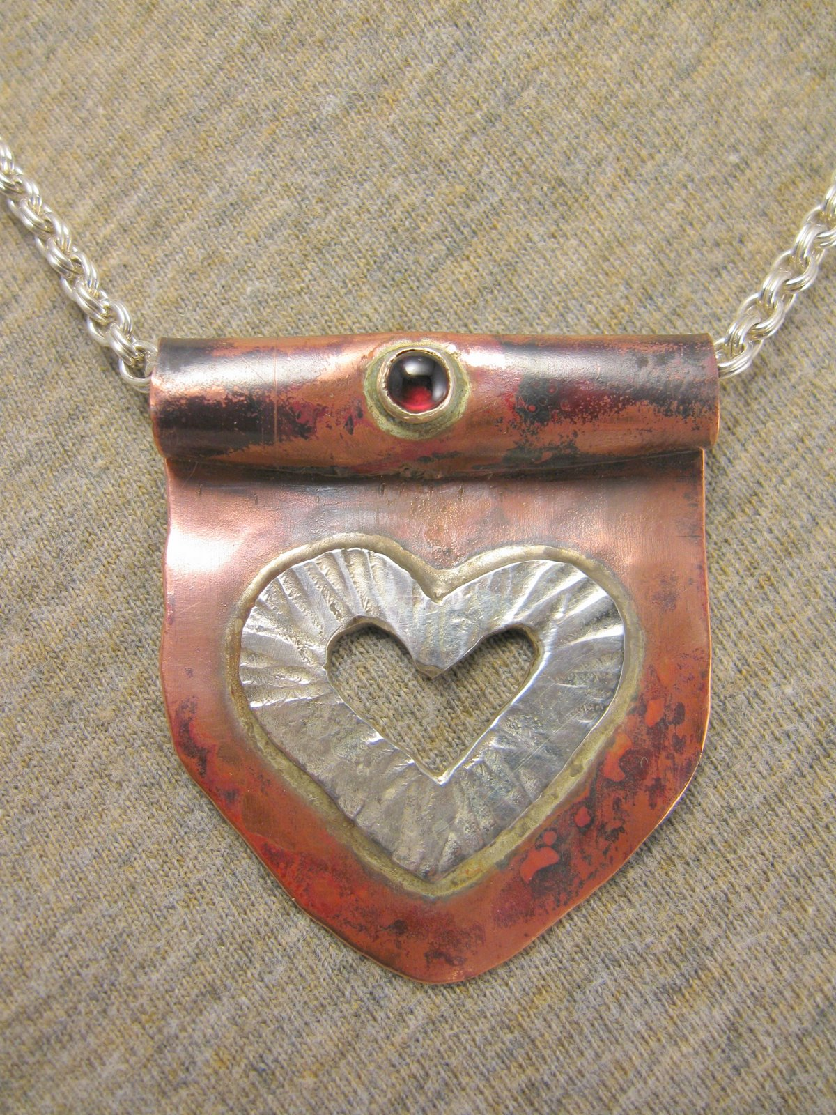 unrolling heart necklace