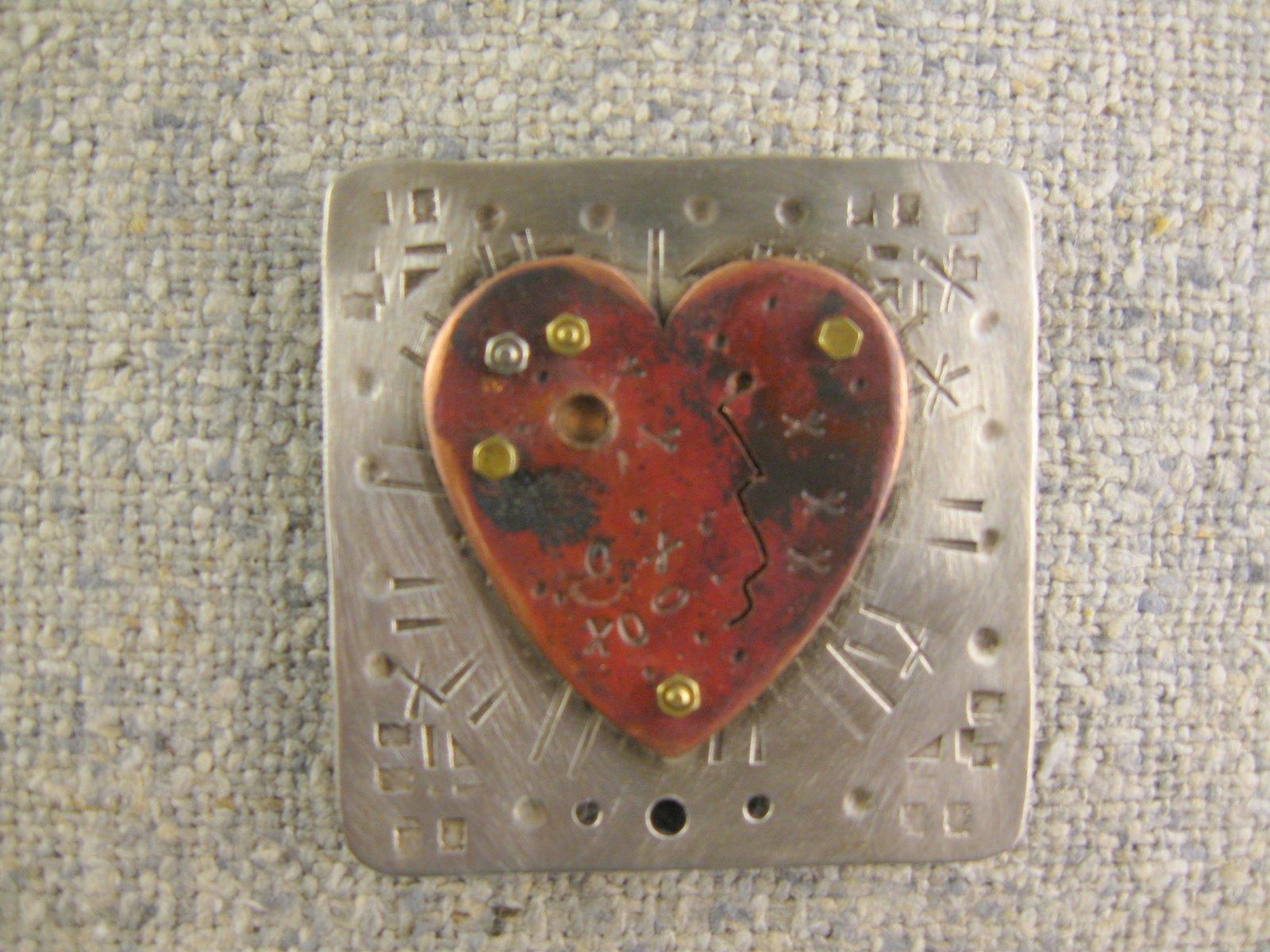 marked heart pin