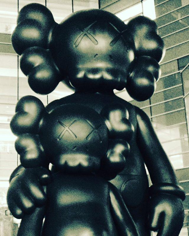 "Post modern Mickey Mouse/deadmau5 sculpture ""Waiting"" by KAWS. I like it, but I like weird shit. #detroit #art #compuware #deadmau5 #mickeymouse #disney #creepy"