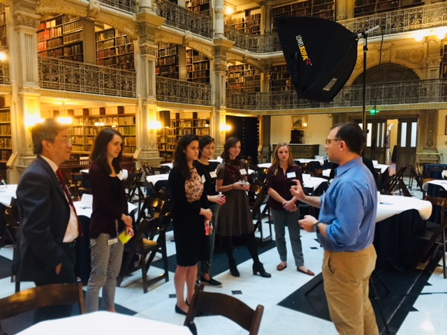 AHW's Global Health Equity Scholars during preparations for a university-wide event held at the George Peabody Library in October, 2017. Photo credit: Sheridan Jones/AHW