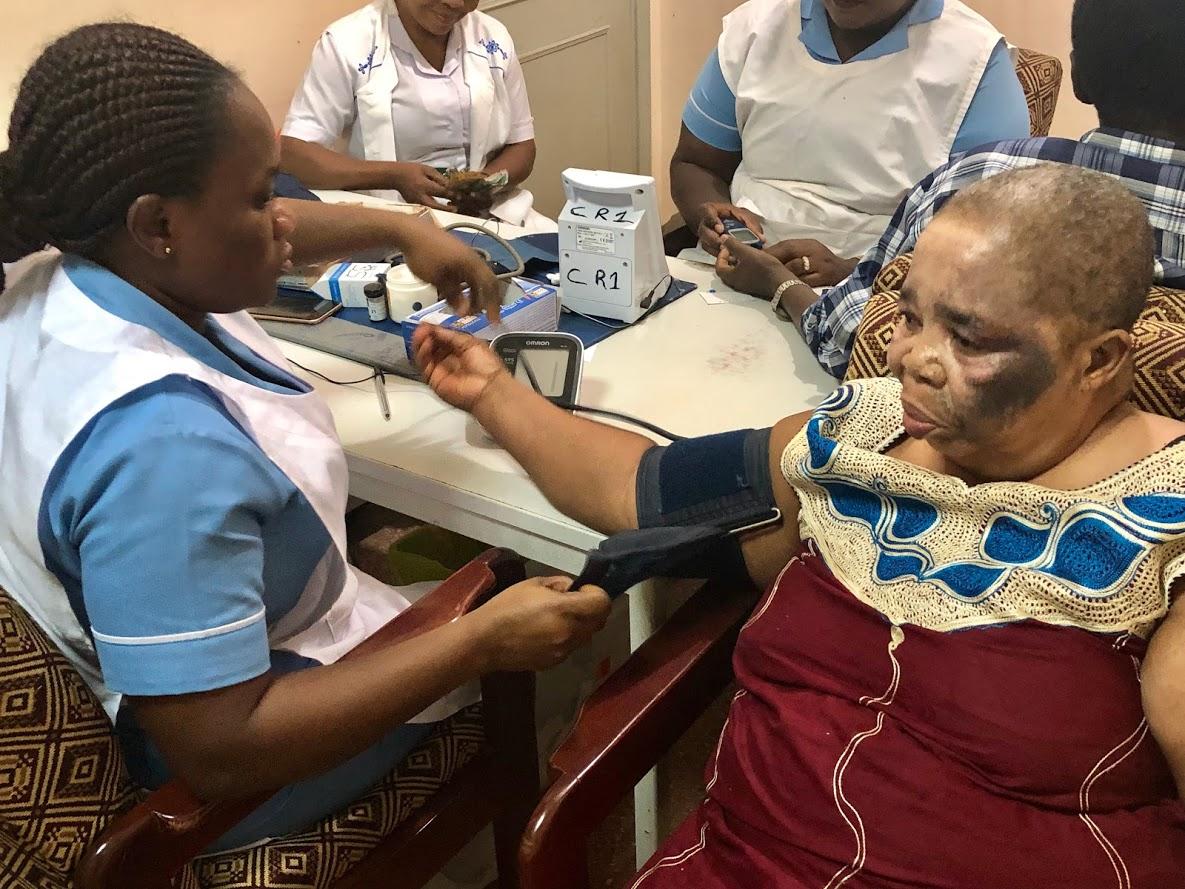 Nurse measuring blood pressure of a patient at Komfo Anokye Teaching Hospital in Kumasi, Ghana