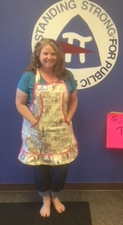 Deborah Tice proudly wears here Kuspuk apron that she completed at the September 2018 Saturday members only workshop.