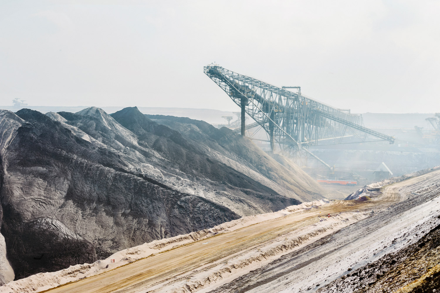 """Renewables are booming, but Germany's use of lignite, the dirtiest coal, hasn't declined. At Vattenfall's Welzow-Süd mine, some of the world's largest machines claw 22 million tons a year from a 45-foot-thick seam. How long will that go on? """"Very long, I hope,"""" said Jan Domann, a young engineer. """"We have enough lignite."""""""