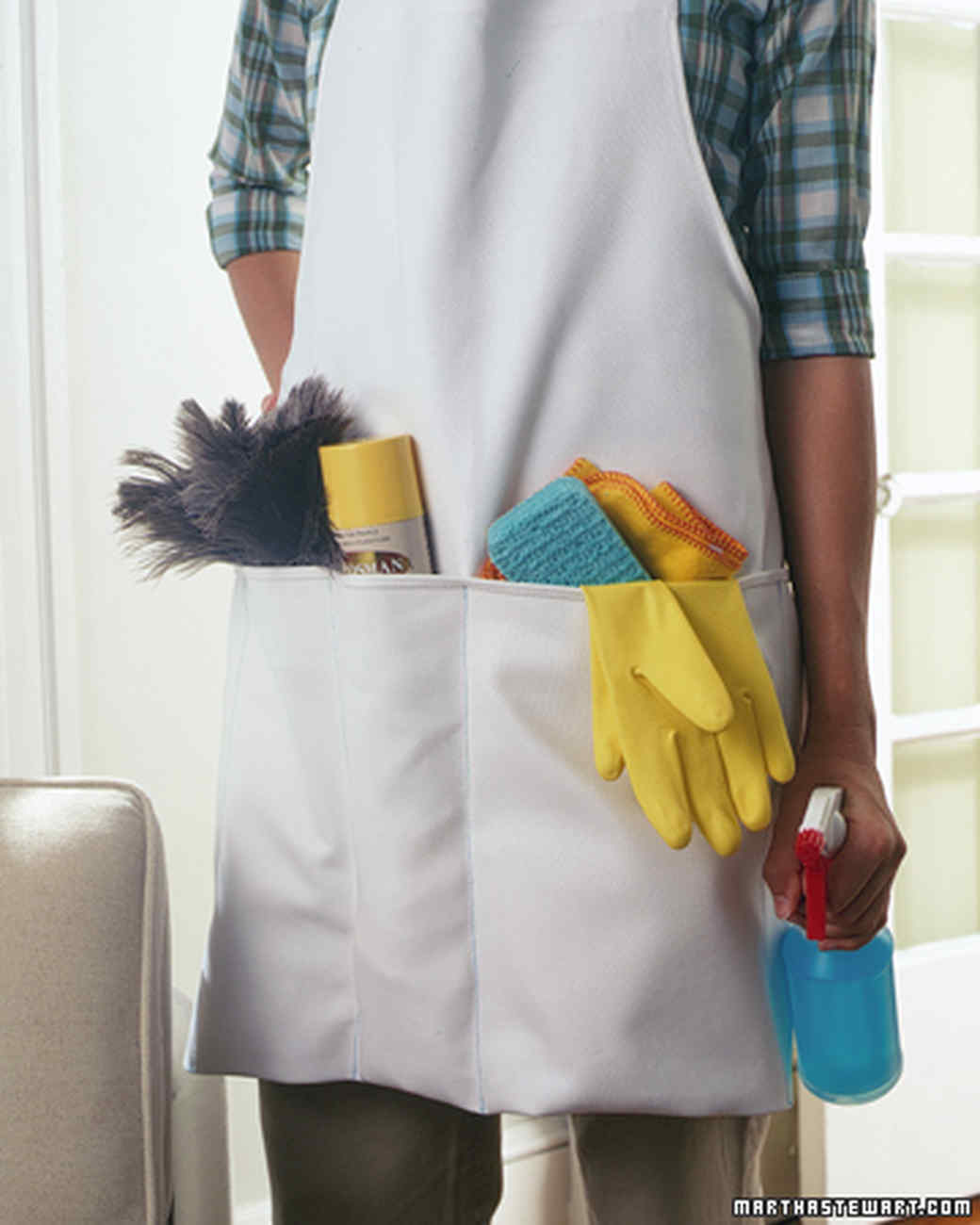 Carryall Apron - Before you throw out that old kitchen apron, stash your essential spring-cleaning supplies in the pockets and use it as you go from room to room. It will leave your hands free to scrub and polish and you won't have to lug a heavy cleaning bucket around the house.To create storage compartments, turn up the bottom 12 to 18 inches of a long apron. Determine pocket widths by using the size of your cleaning supplies as guides. Stitch vertically using a sewing machine