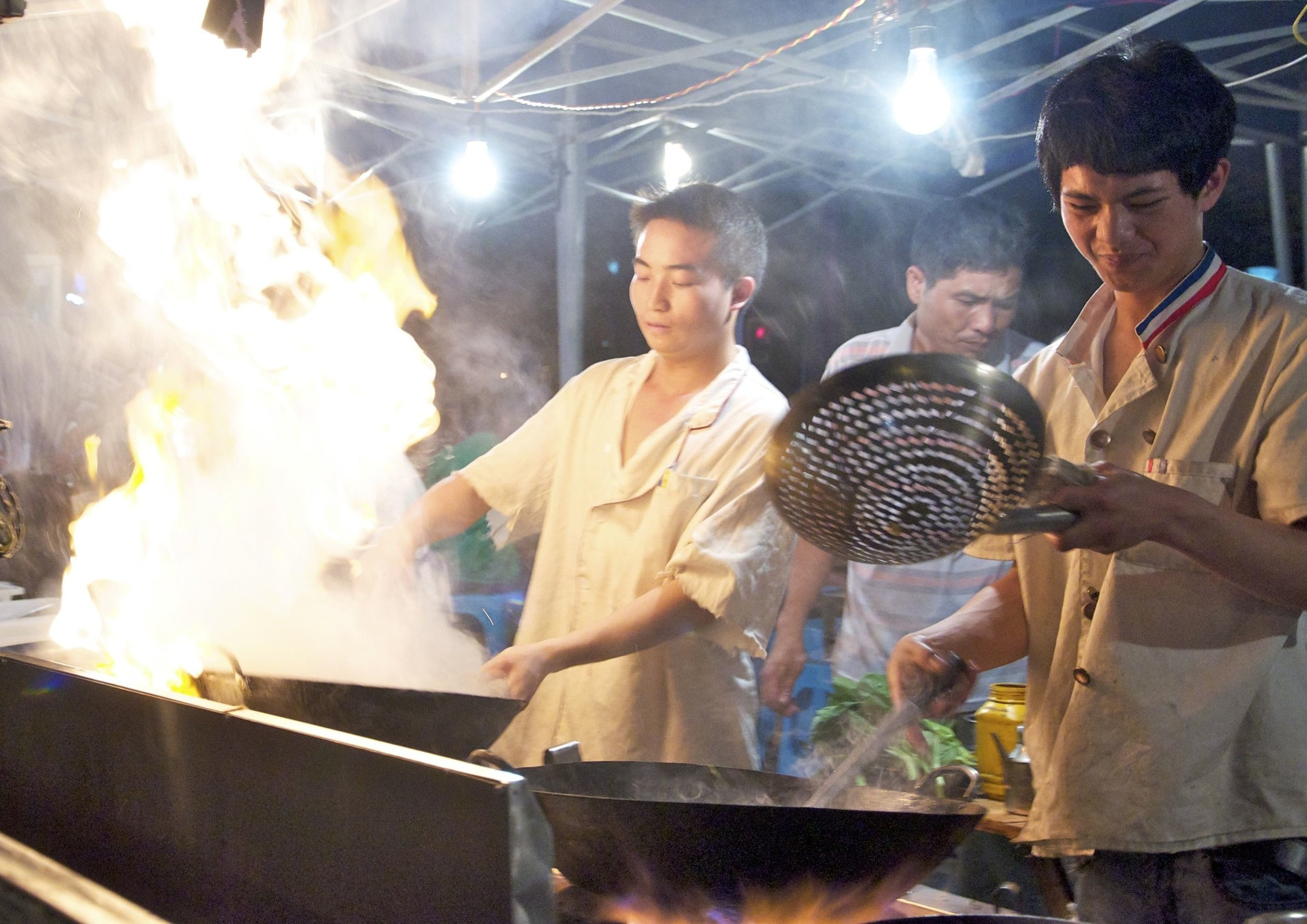 Chefs preparing street food in Guiyang