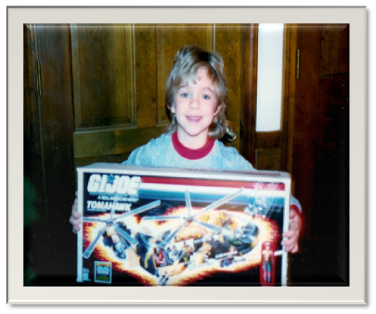 "Age 6. Kaig loved playing with legos, G.I. Joe and many other stereotypical ""boy's"" toys."