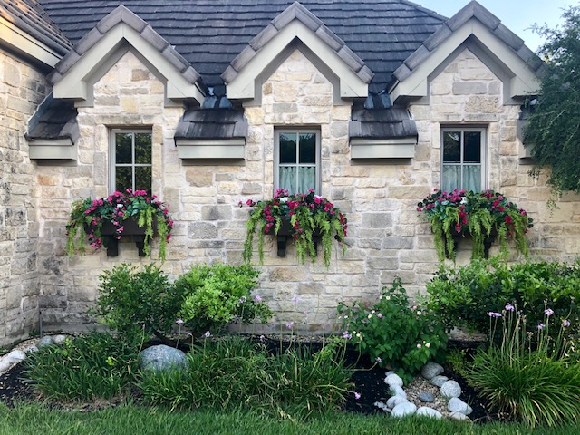 window-boxes-with-faux-flowers-and-ferns