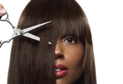woman cutting her hair