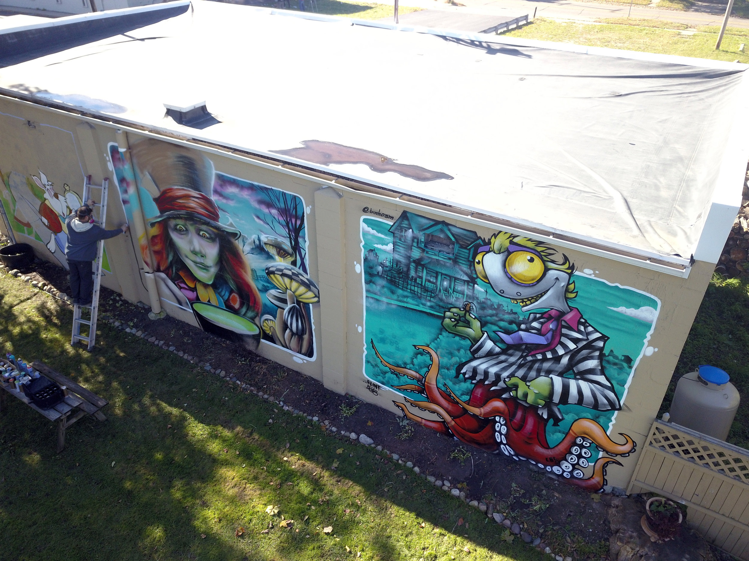 """totem books' neighbor provided access to their private yard so charles boike, kevin """"scraps"""" burdick & binho ribeiro could adorn the book warehouse with narrative character murals."""