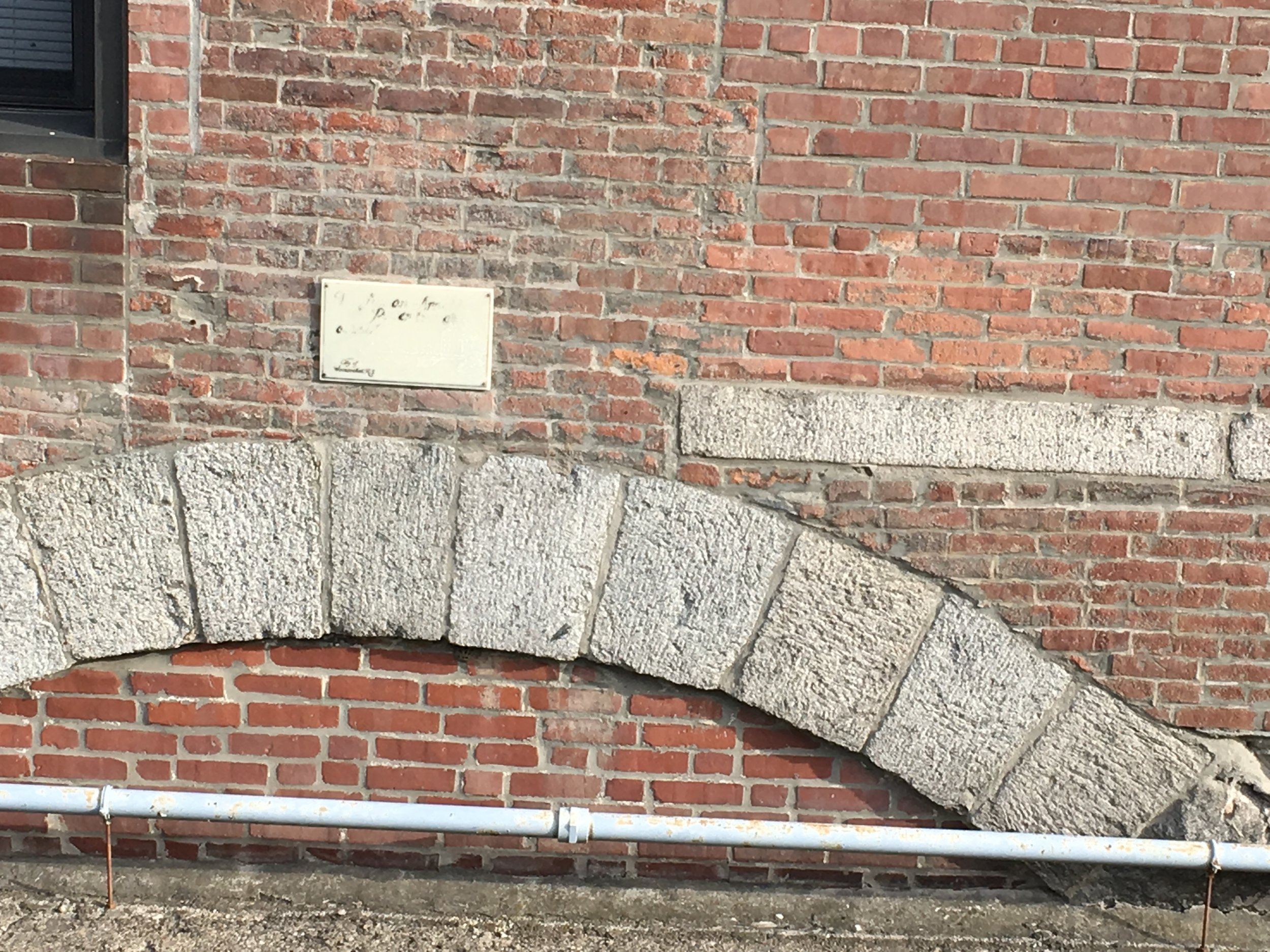 We found a plaque on the side of the Lippitt Mill (now apartments), but it's been so worn away that we couldn't read it.