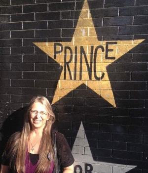 Kathy Holzer poses in front of Prince's First Avenue star.