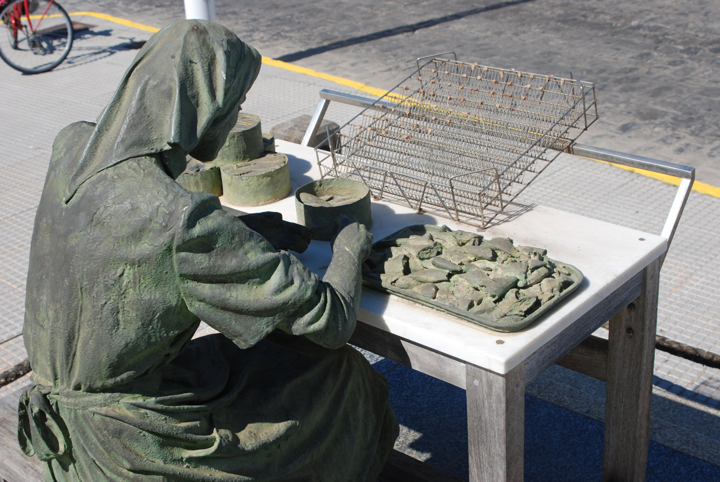 This monument of The Fish Preserving Lady, shows a a woman filleting fish in the Southern Spanish tradition still practiced today.