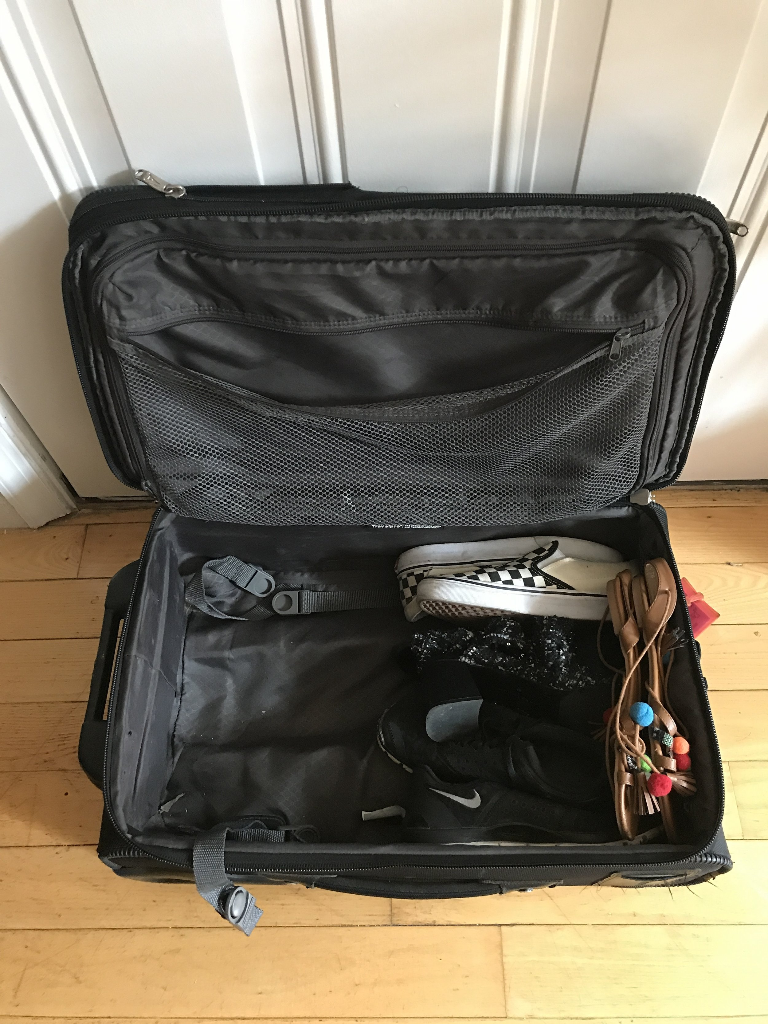 four pairs of shoes at the bottom of my bag
