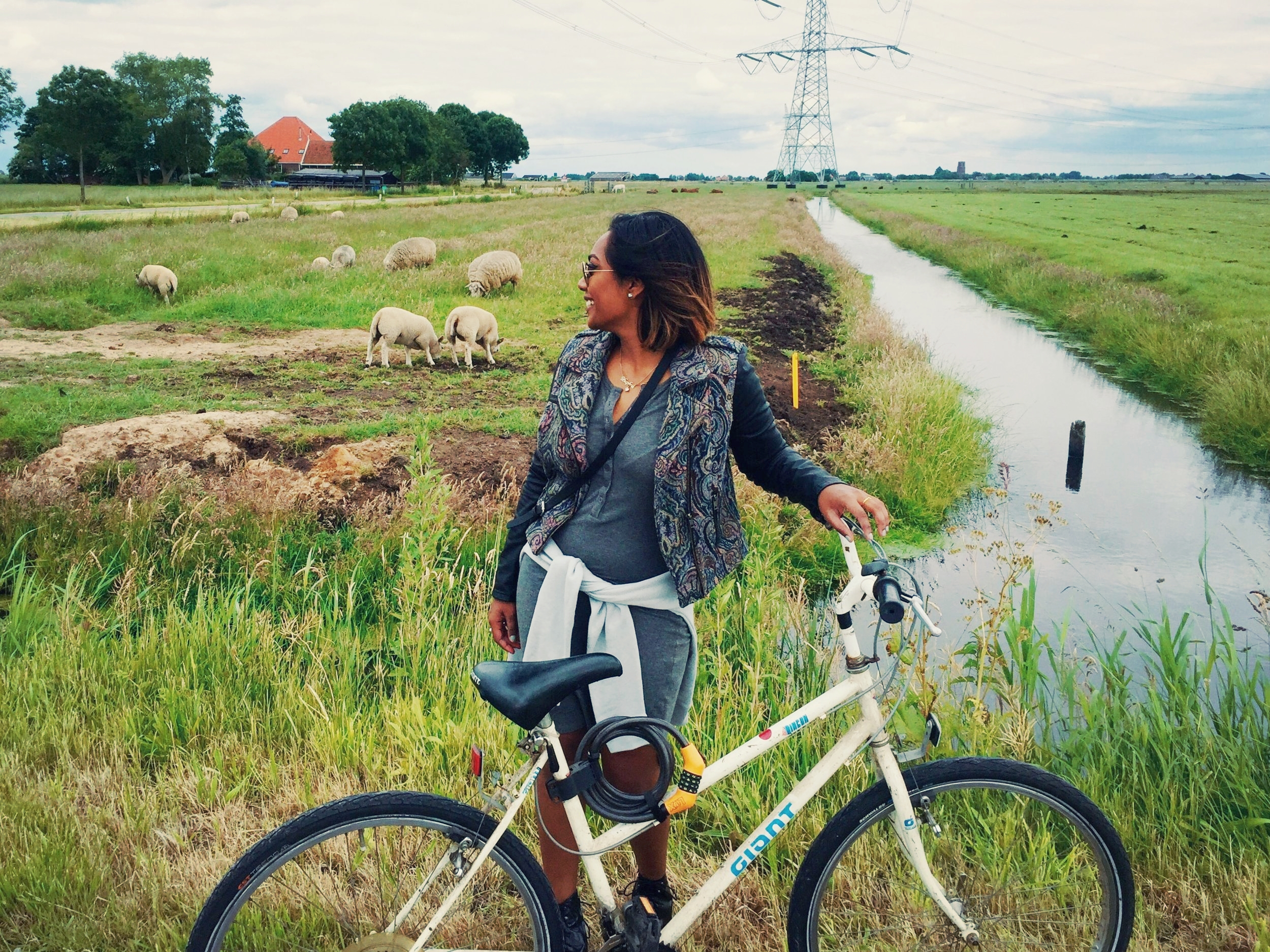 My first layover in Amsterdam, biking in a dress and boots with a heel. *sigh*