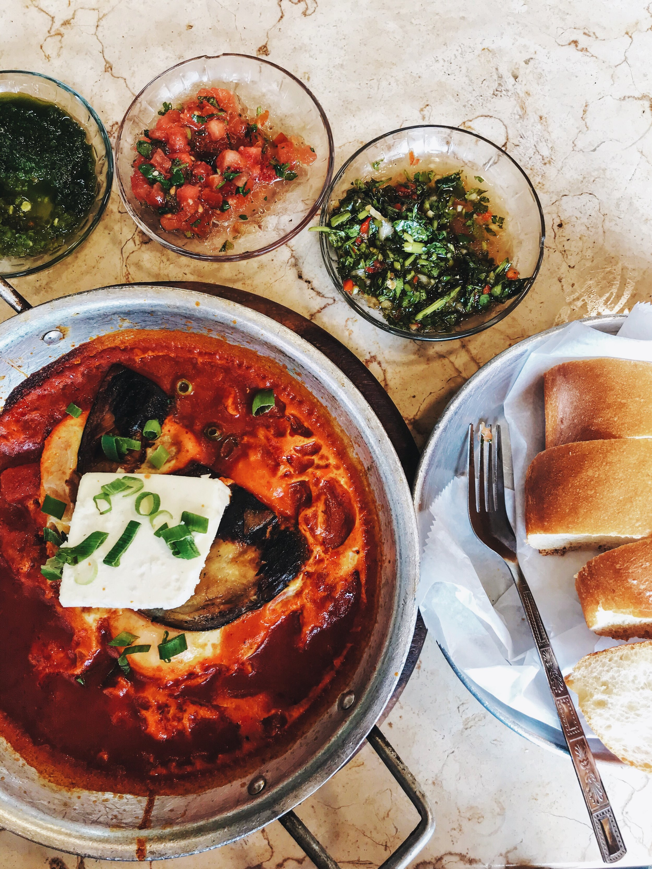 Shakshuka is a savory Middle Eastern dish comprised of baked eggs in a rich tomato sauce.