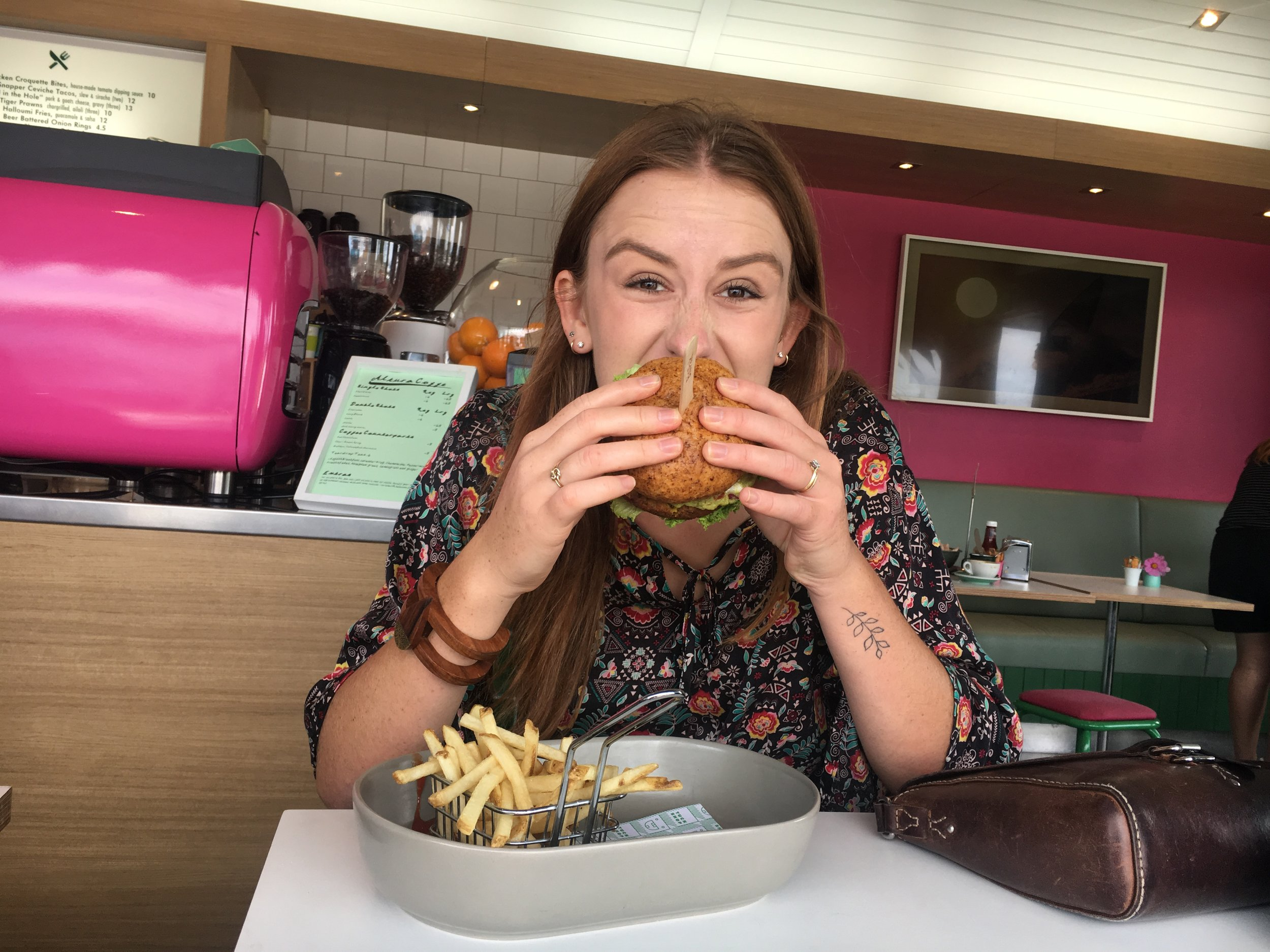 Munching on a gluten free vegetarian burger and fries