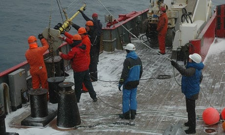 Helen Czerski, in the blue coat, helps lower the bubble buoy over the stern of the British Antarctic Survey ship, the James Clark Ross. Photograph: Helen Czerski